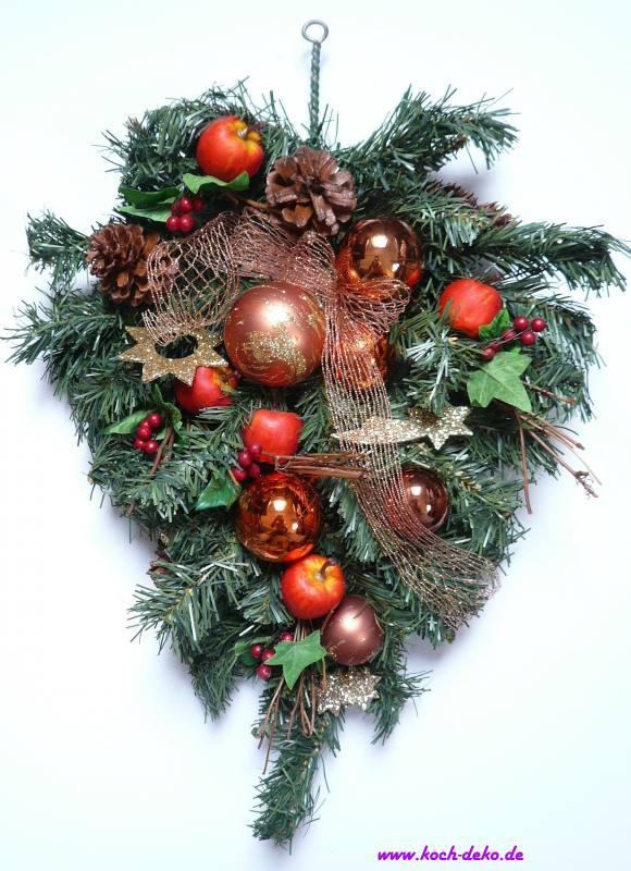 weihnachtlich dekorierter tannenzweig kupfer pfel. Black Bedroom Furniture Sets. Home Design Ideas