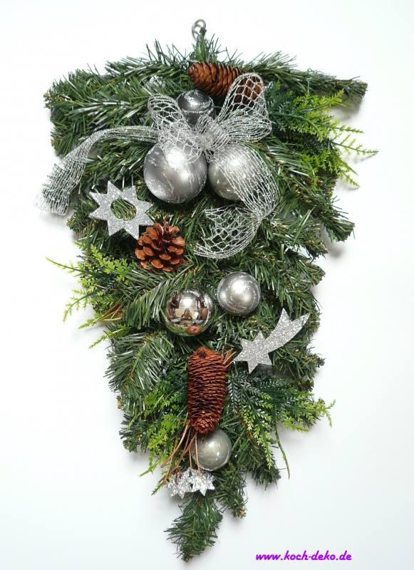 weihnachtlich dekorierter tannenzweig silber grau. Black Bedroom Furniture Sets. Home Design Ideas